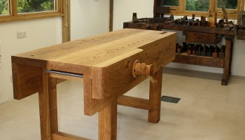 Workbench in Customer's workshop - Antique bench behind with collection of hand tools