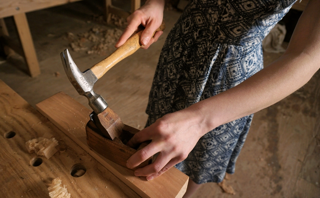 wooden hand planes are adjusted with a plane hammer (use a nice small one if you can)