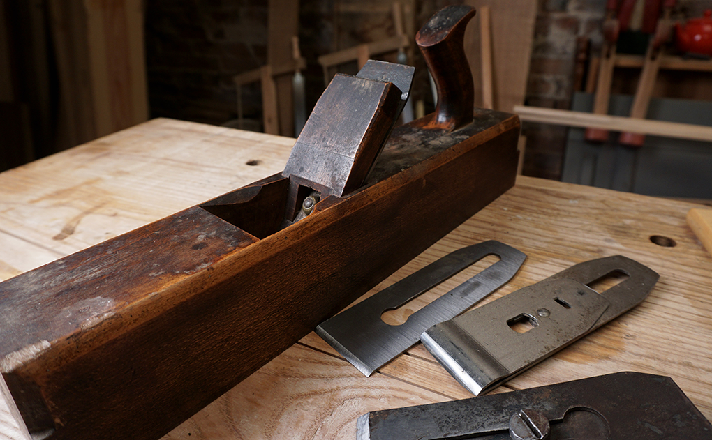 Old wooden hand plane, with laminated plane iron