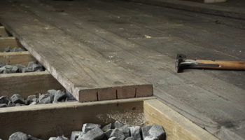 Relief cuts to floor boards