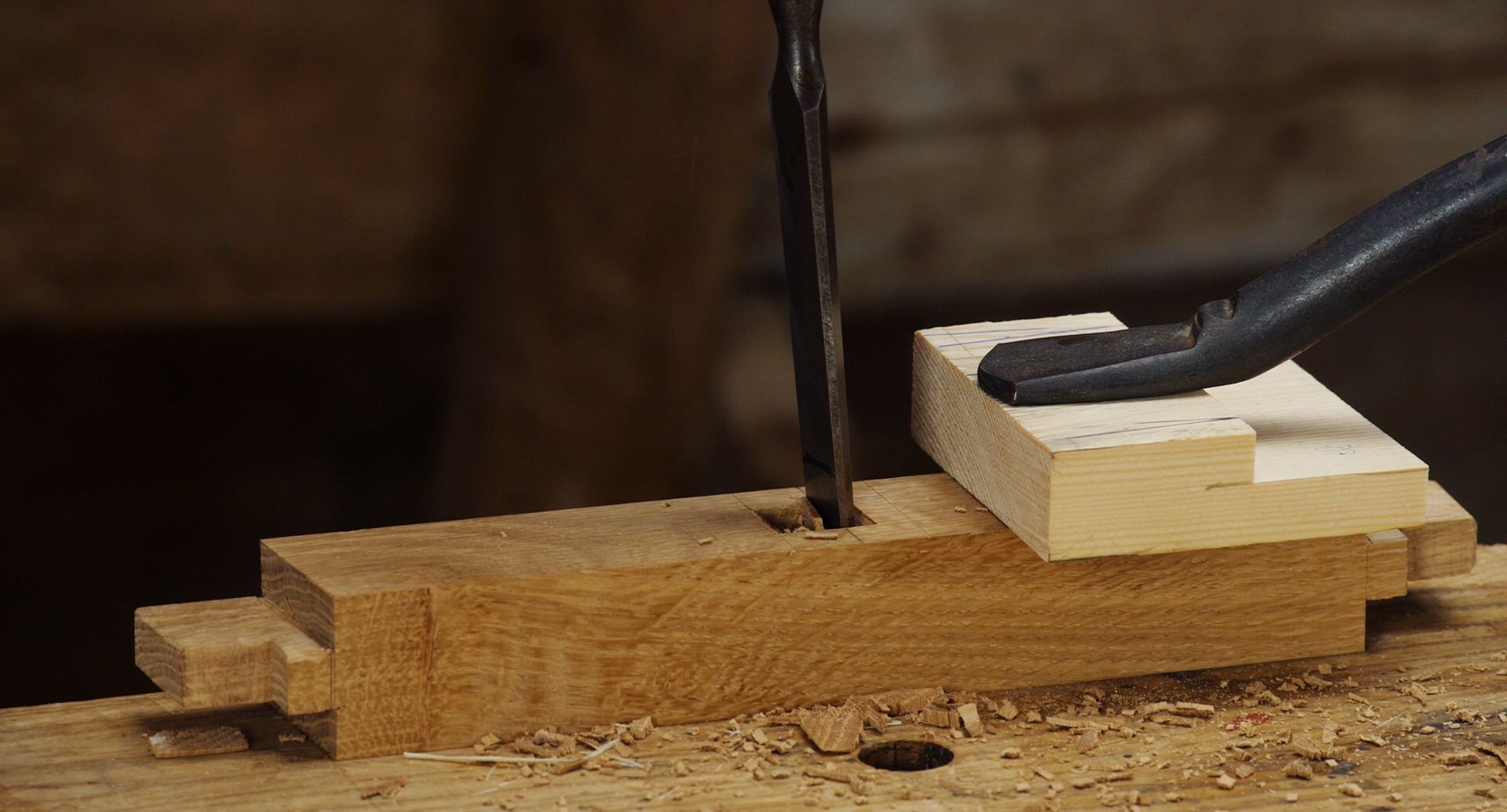 clamping on the workbench top using a holdfast